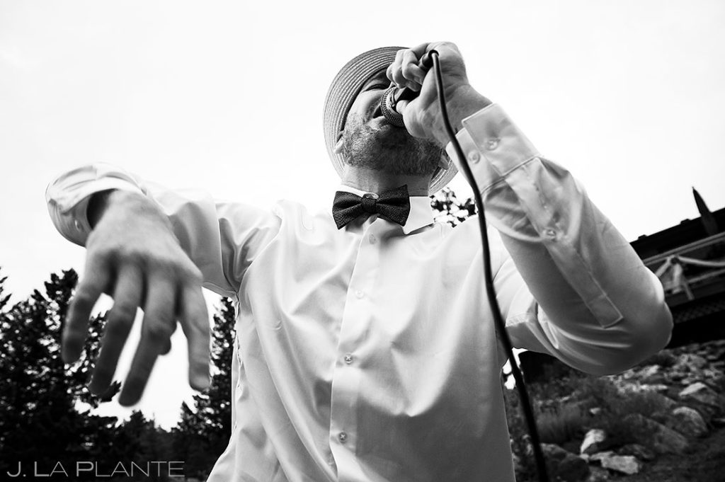 rapper performing live at backyard wedding in Boulder