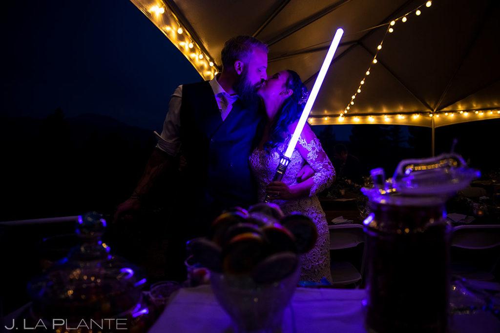 bride and groom kissing at backyard wedding in Boulder