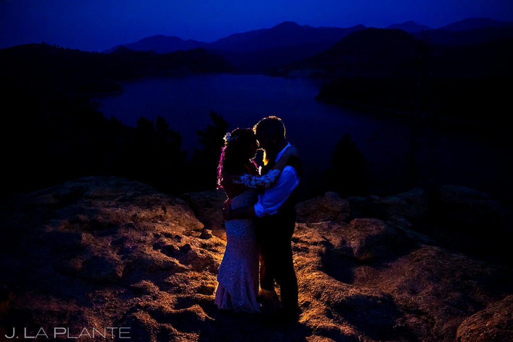 nighttime portrait of bride and groom at backyard wedding in Boulder