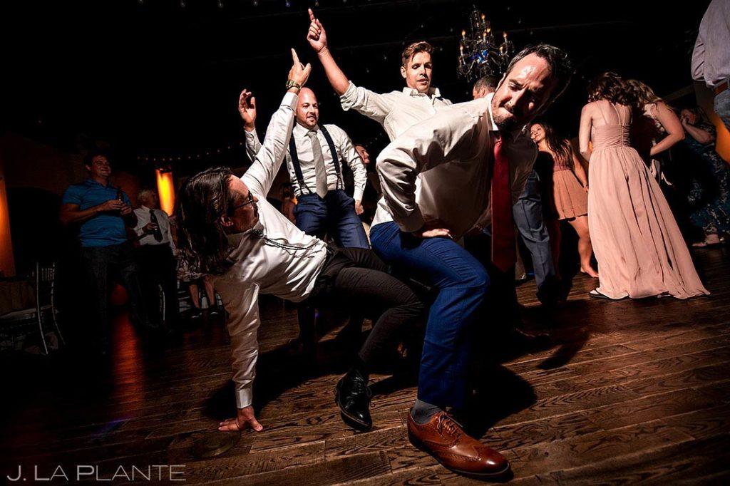 groomsmen going crazy on the dancefloor at Wellshire Event Center wedding