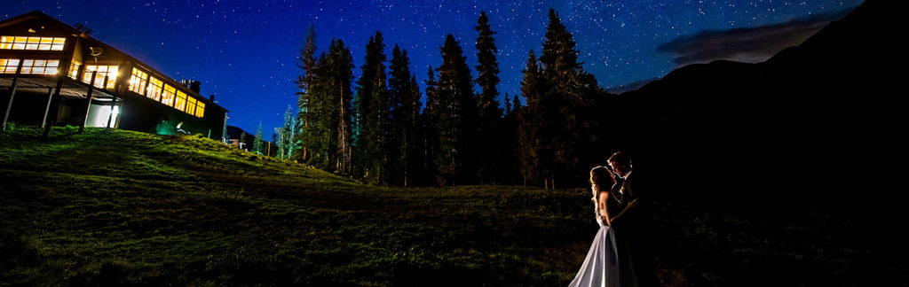 bride and groom kissing under the stars during Arapahoe Basin wedding