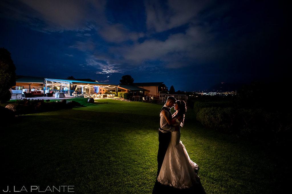 nighttime wedding photo of bride and groom at Garden of the Gods Resort wedding