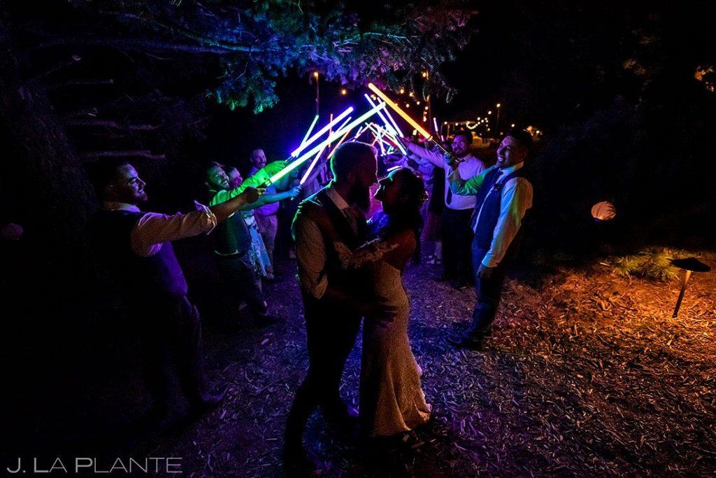 bride and groom light saber send off at backyard wedding in Boulder