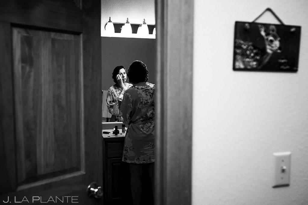 bride getting ready for black canyon homestead wedding