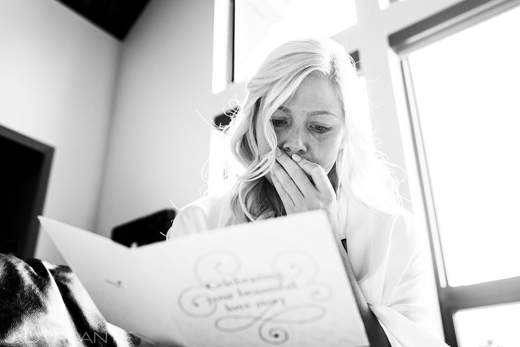 bride crying while reading a letter from her mother