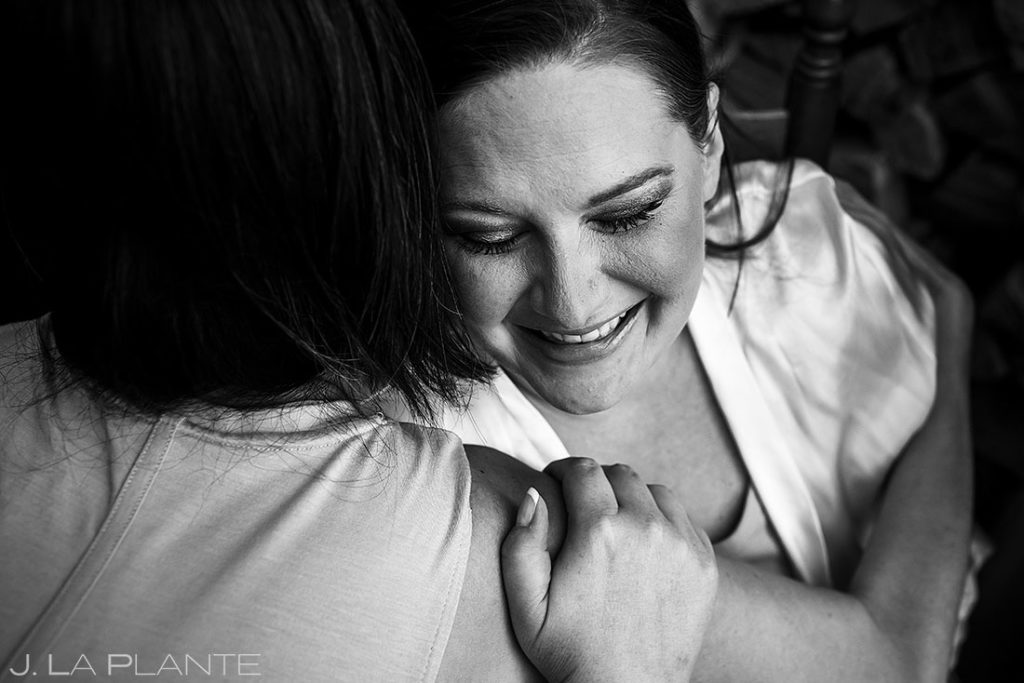 bride hugging bridesmaid before Eagle-Vail Pavilion wedding