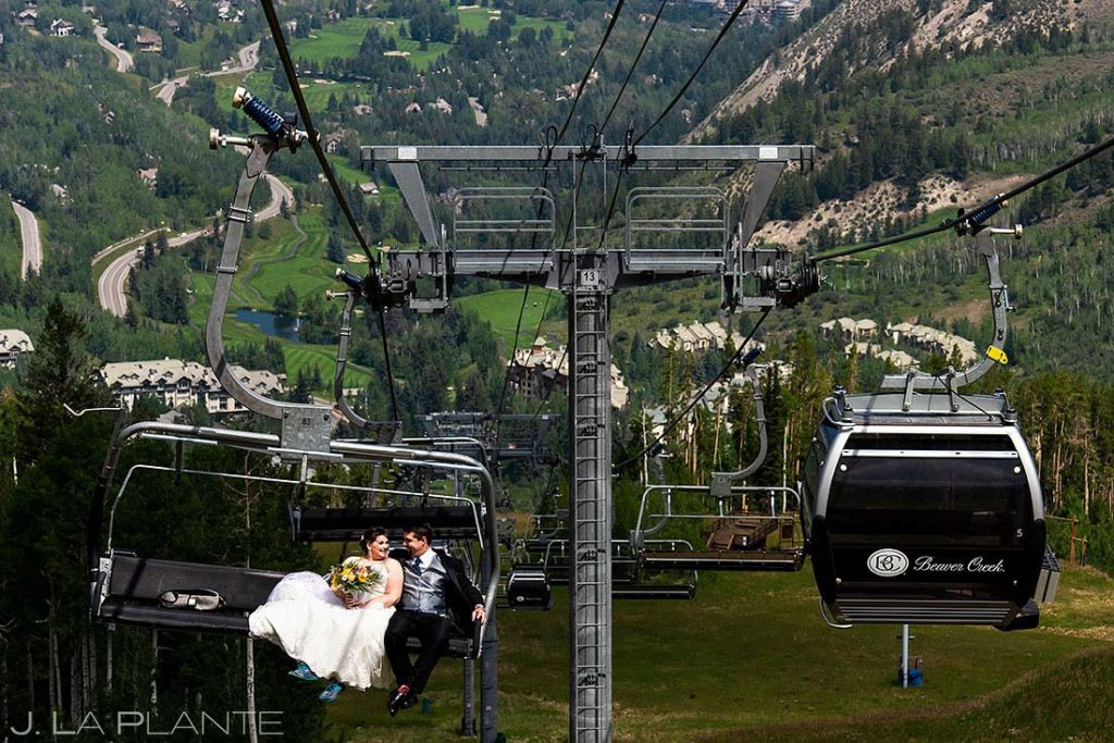 bride and groom riding chairlift up Beaver Creek Mountain
