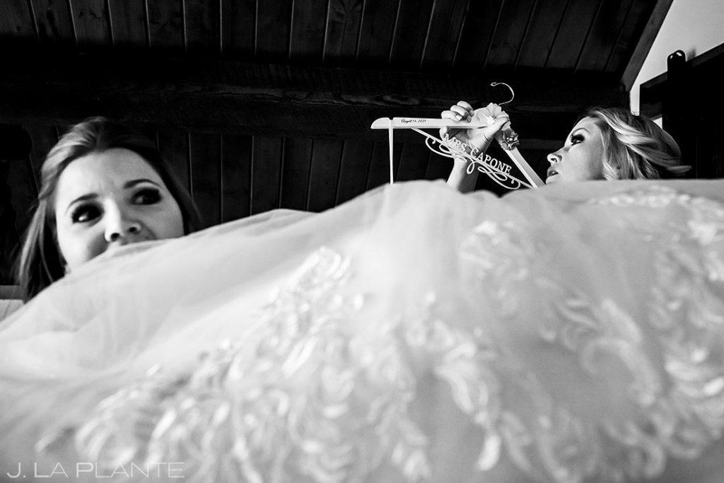 bride getting into dress before Estes Park Resort wedding