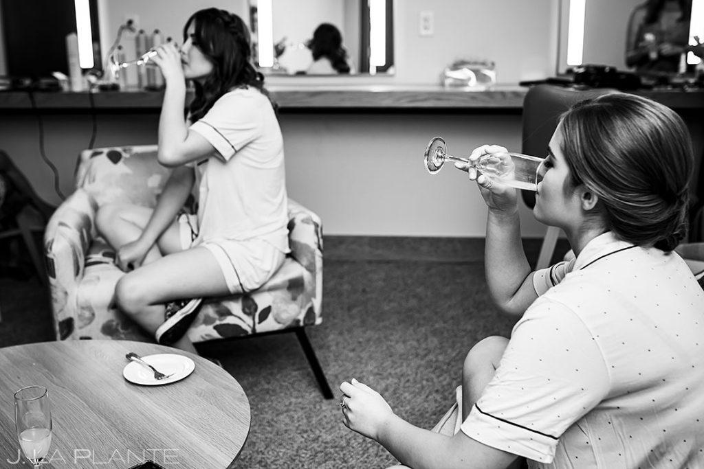 junior bridesmaids drinking champagne before wedding ceremony