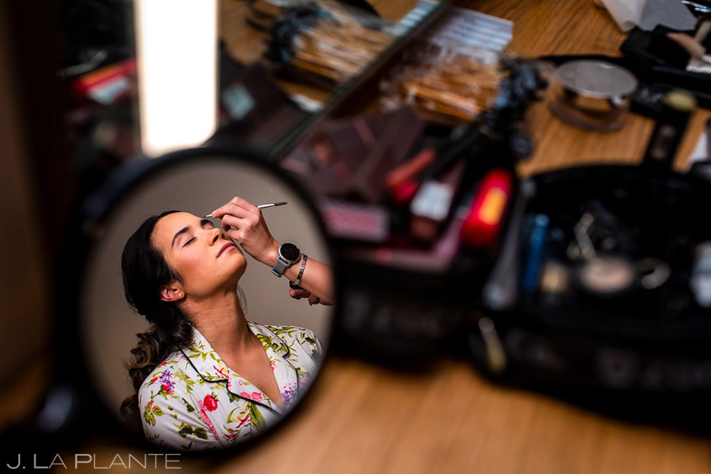 bride getting ready for Spruce Mountain Lower Ranch wedding