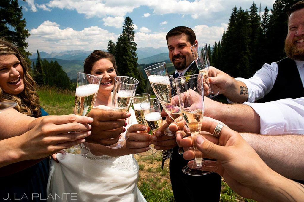 bride and groom popping bottles before Eagle-Vail Pavilion wedding