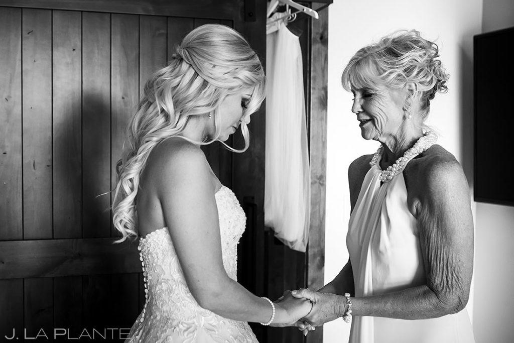 bride praying with mother before Estes Park Resort wedding