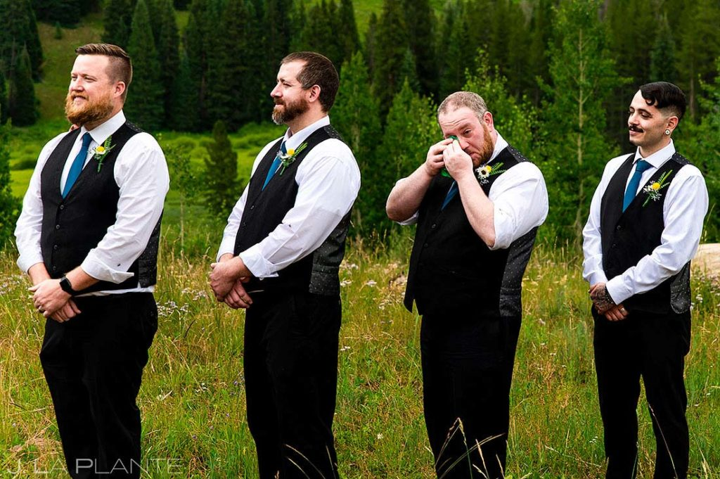 groomsman crying during the wedding ceremony