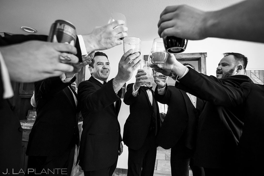 groomsmen drinking whiskey before Estes Park Resort wedding