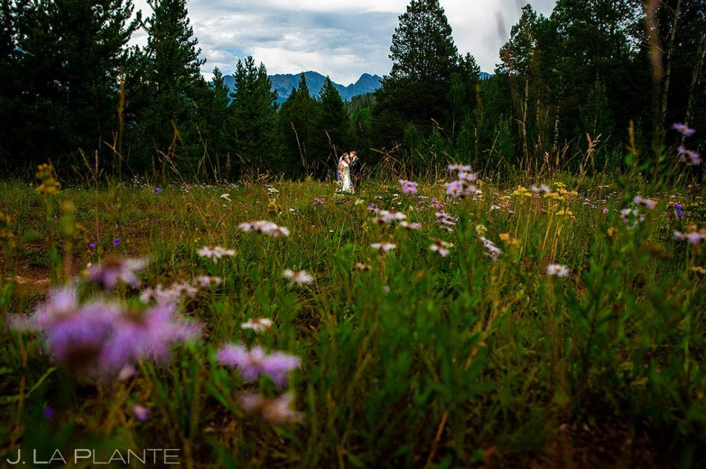 bride and groom with mountain wildflowers