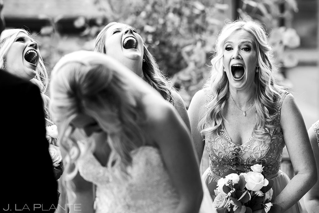 bridesmaids laughing out loud during the vows