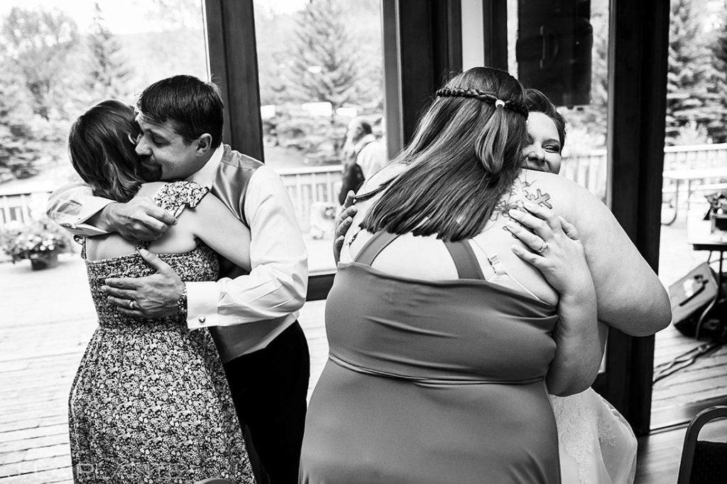 bride and groom hugging guests at Eagle-Vail Pavilion wedding