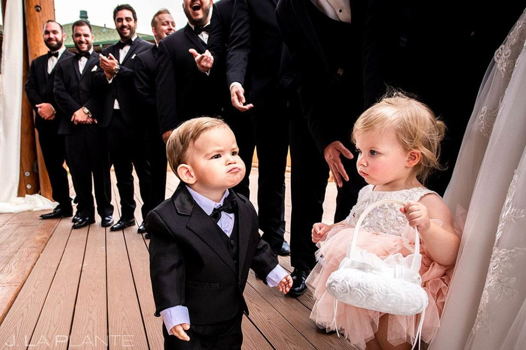 ring bearer making funny faces during wedding ceremony