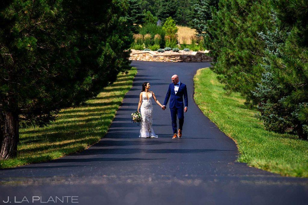bride and groom walking around ranch wedding venue