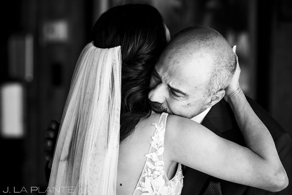bride hugging father at Spruce Mountain Lower Ranch wedding