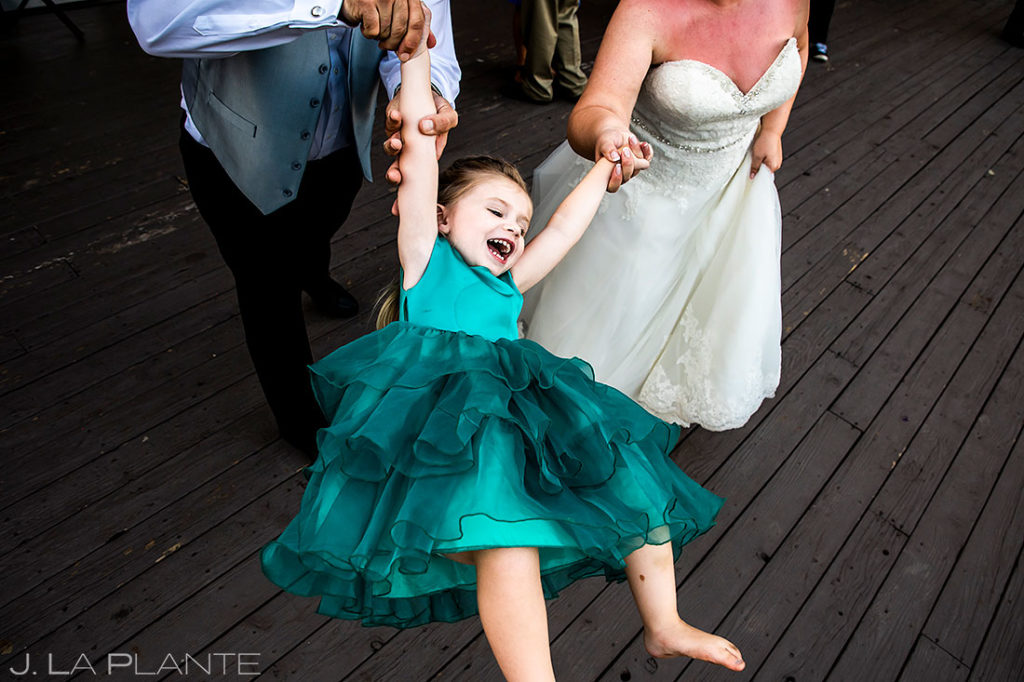 bride and groom dancing with flower girl at Eagle-Vail Pavilion wedding