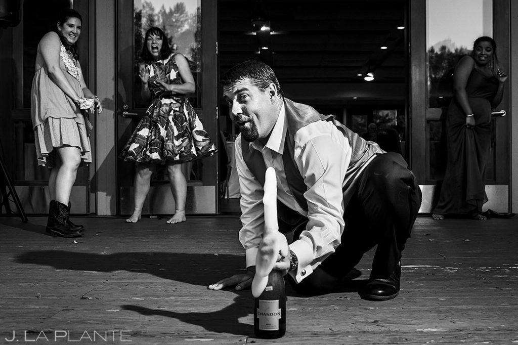 groom spraying champagne on the dance floor