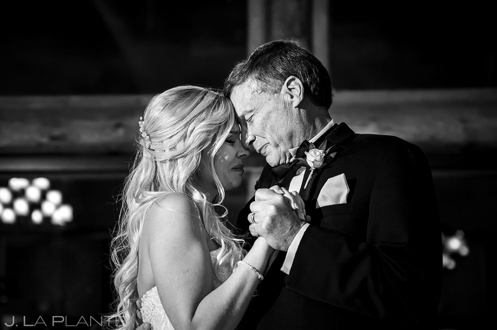bride and father crying during father daughter dance
