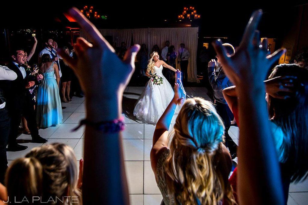 bouquet toss at Estes Park Resort wedding reception