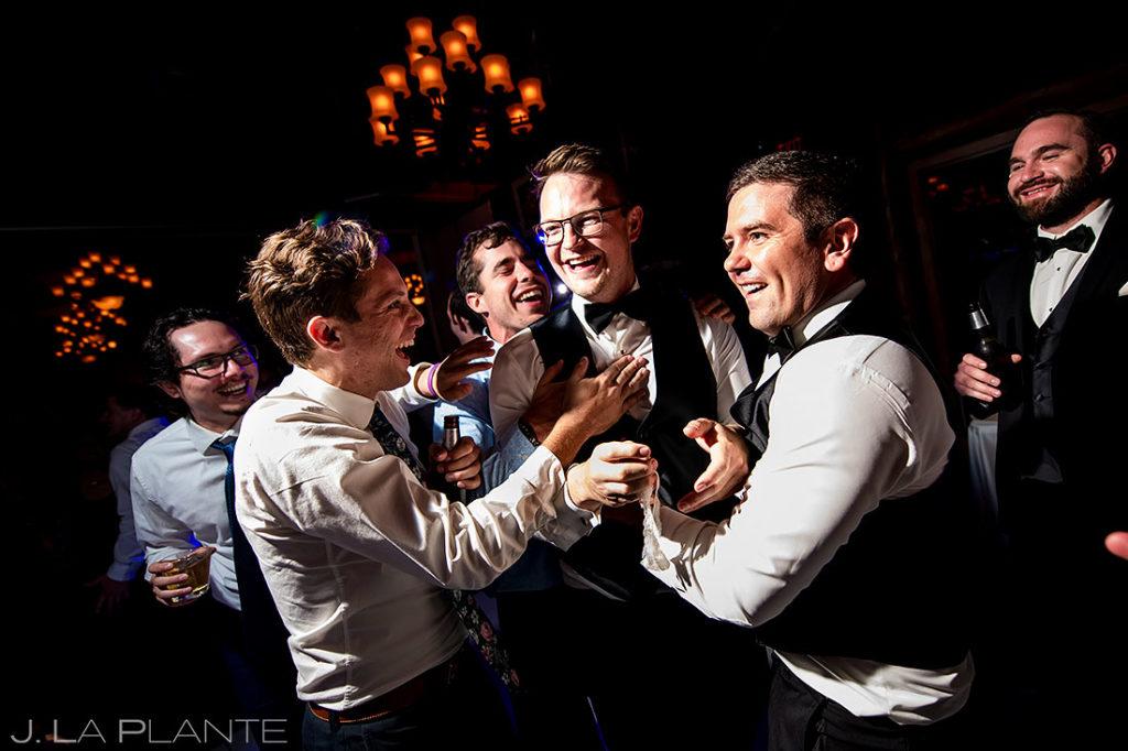 garter toss at Estes Park Resort wedding reception