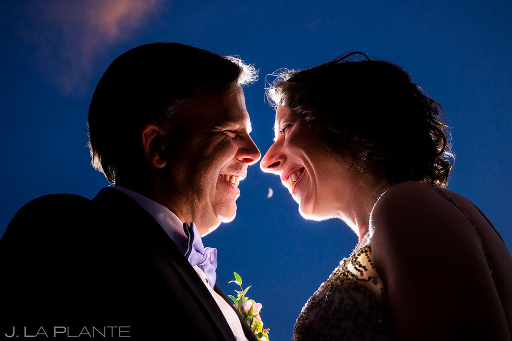 bride and groom portrait under the moon