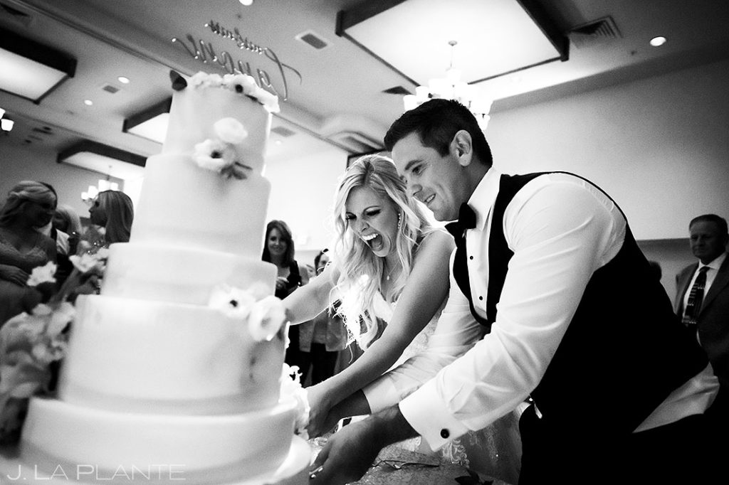 bride and groom cutting the cake during the reception