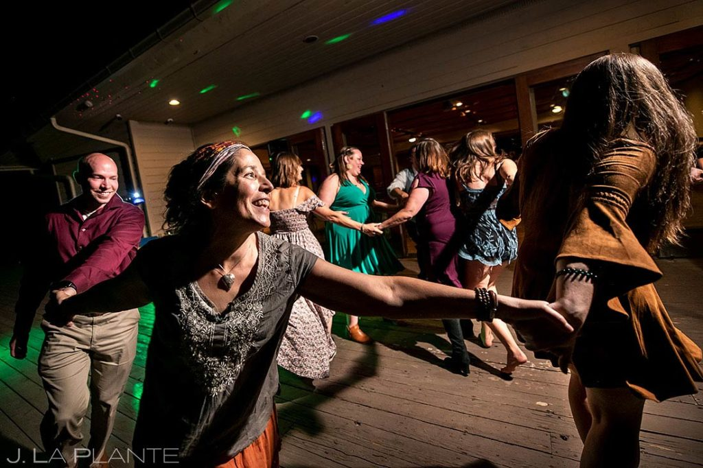 wedding guests dancing at reception dance party