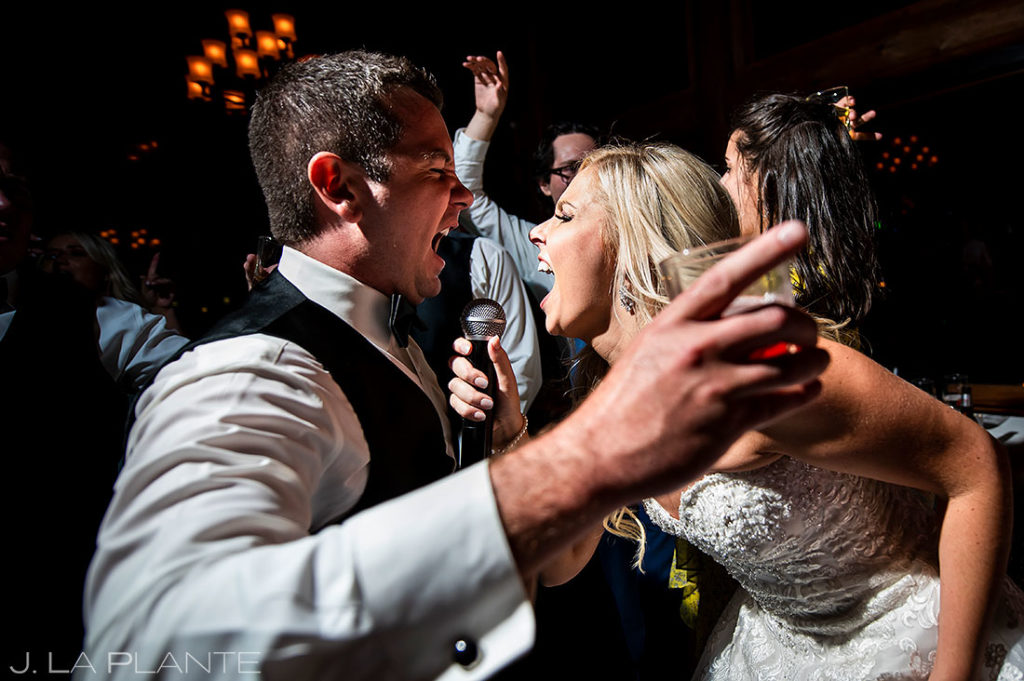 bride and groom singing a song together during reception
