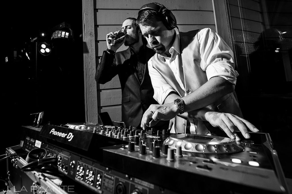 groom stepping in for the DJ during reception