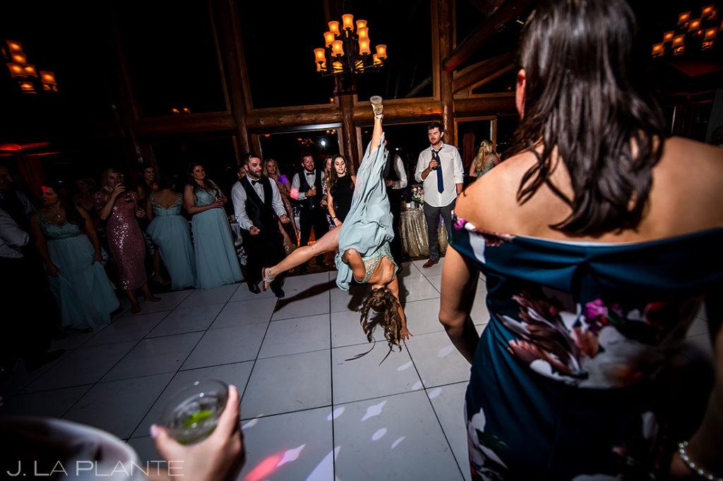 bridesmaid doing a flip on the dancefloor