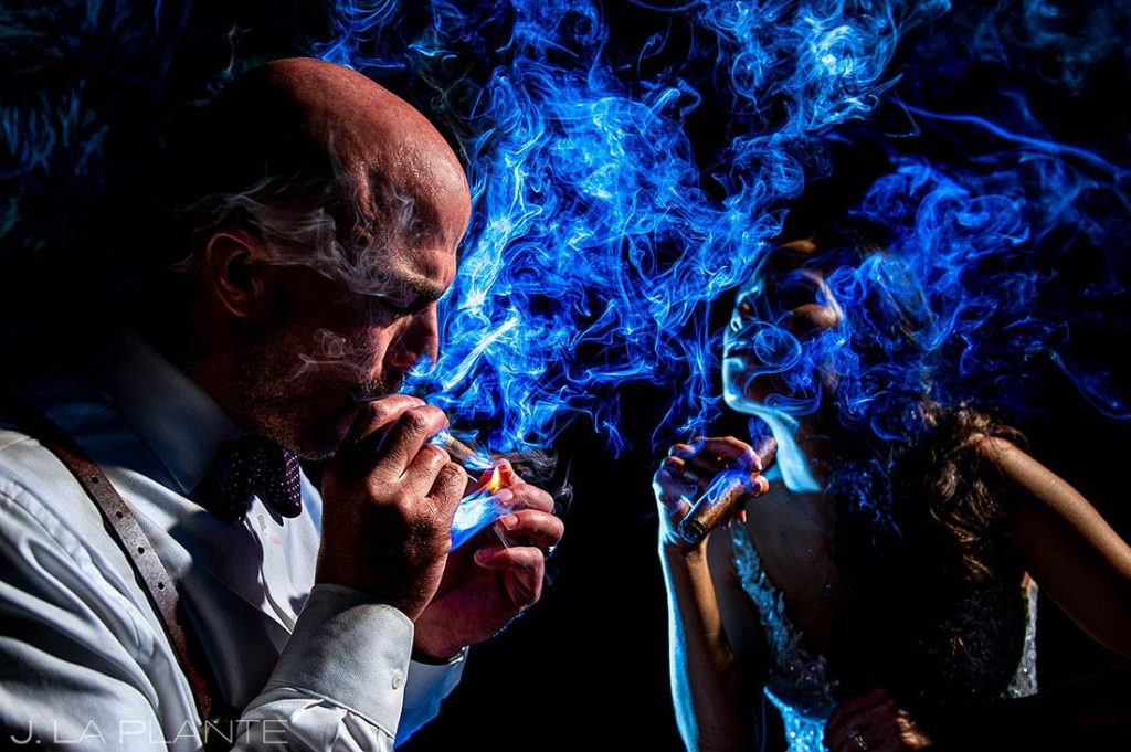 bride and groom smoking cigars at Spruce Mountain Lower Ranch wedding