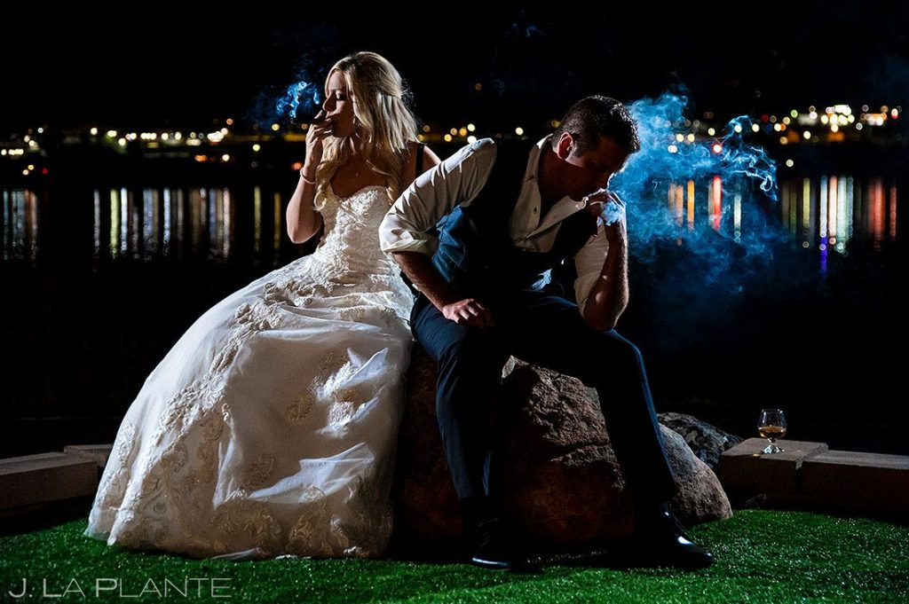 bride and groom smoking cigars at the end of the wedding
