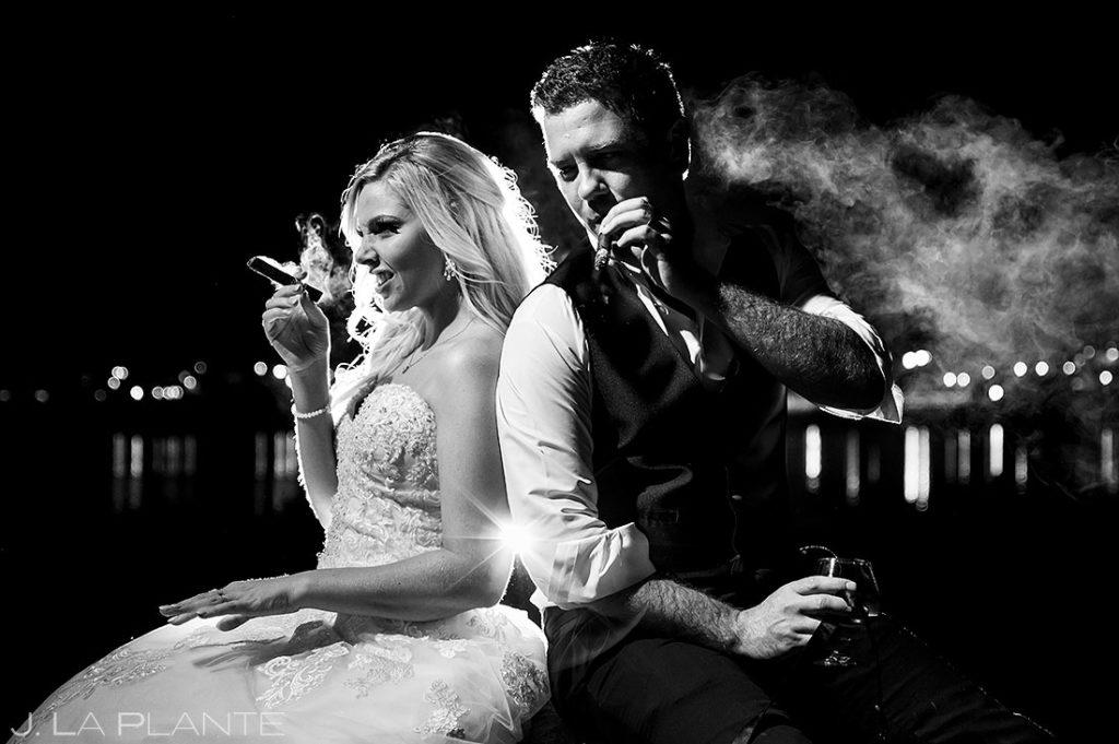 bride and groom smoking cigars at Estes Park Resort wedding
