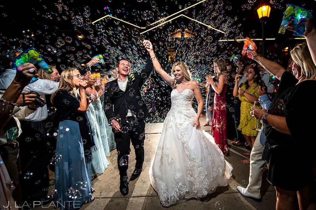 bride and groom bubble send off from Estes Park Resort wedding