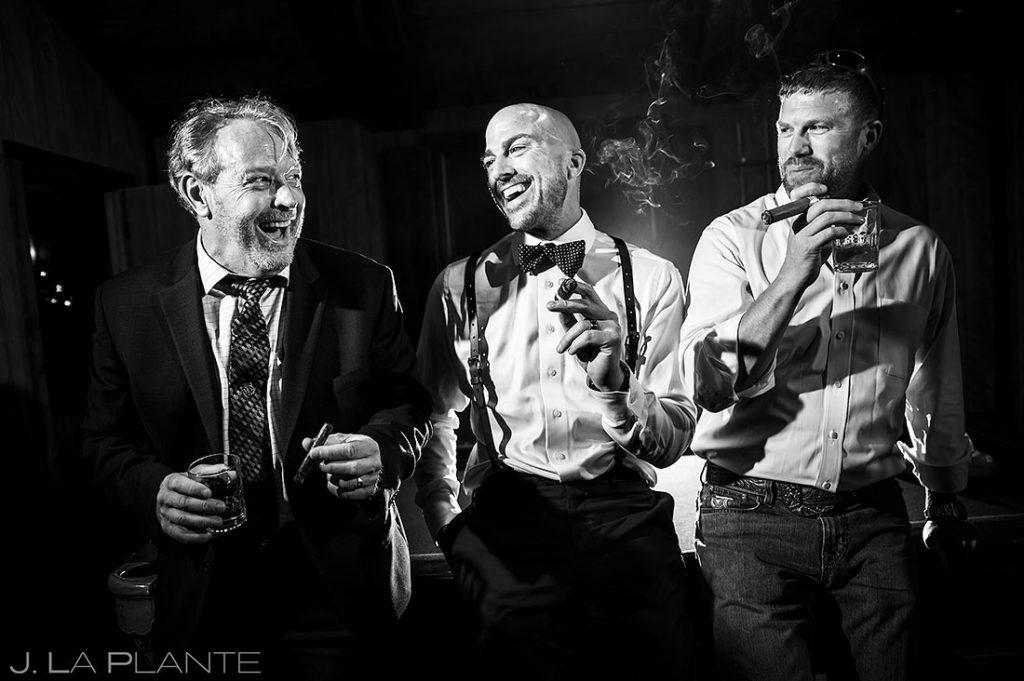 wedding guests smoking cigars during reception