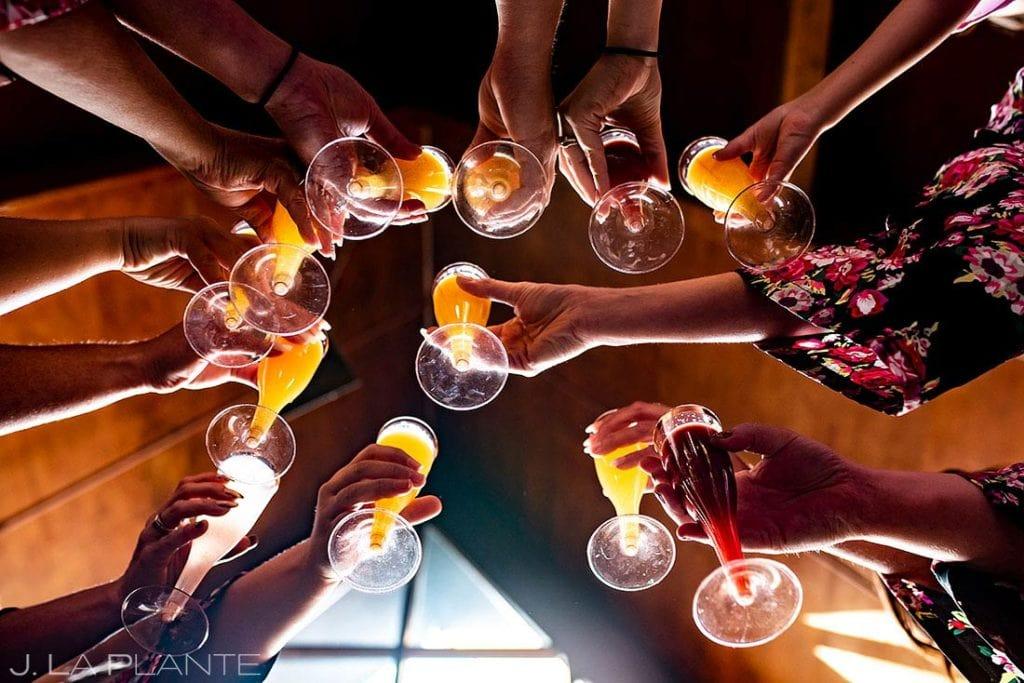 bridesmaids toasting with mimosas before Montana destination wedding
