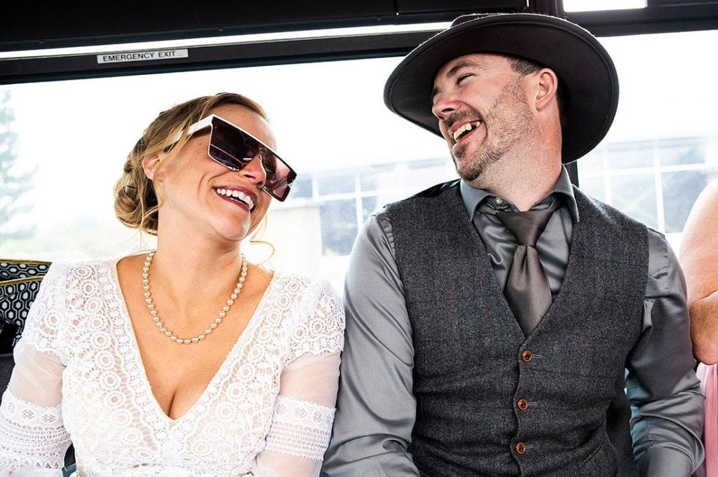 bride and groom on party bus at Montana destination wedding