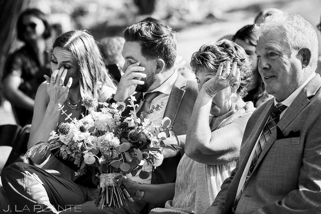 family of bride crying during wedding ceremony