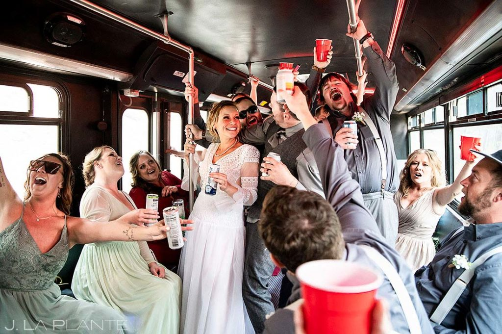 wedding party goofing around on the party bus