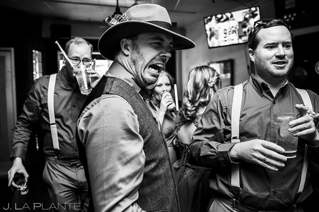 groom making funny face after doing a shot in a dive bar