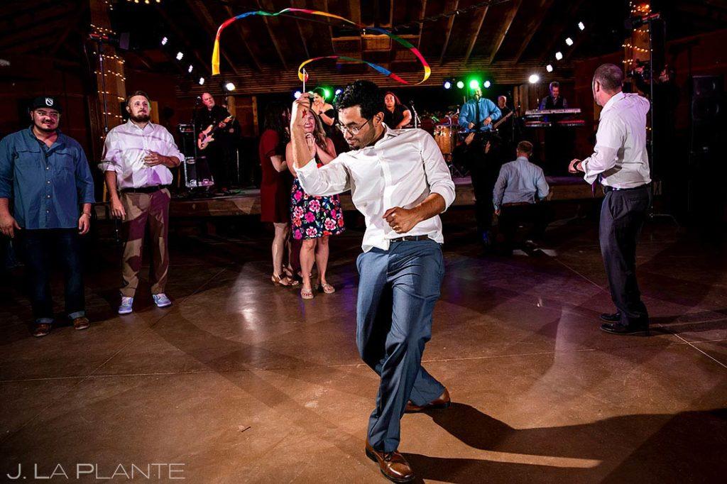 wedding guest twirling ribbon during wedding reception