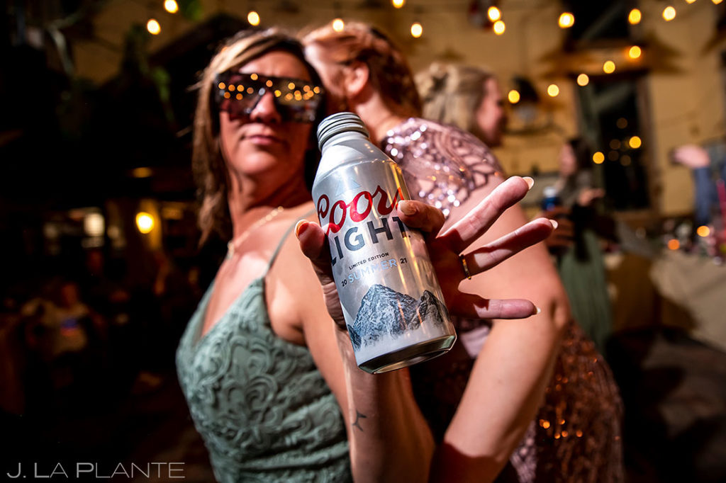 bridesmaids drinking Coors Light on the dancefloor