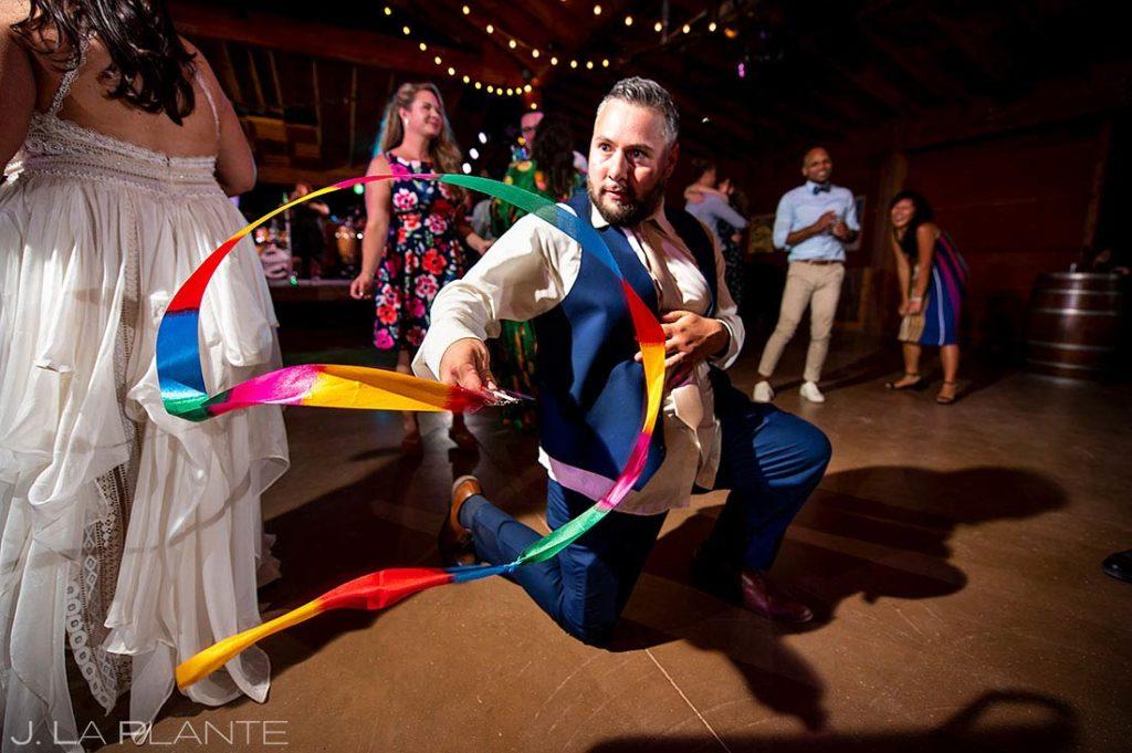 groom dancing at summer wedding at Planet Bluegrass