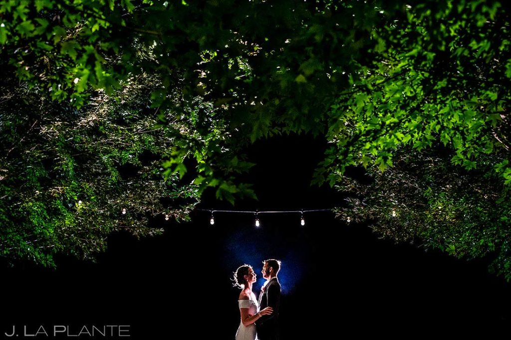 nighttime portrait of bride and groom at Greenbriar Inn microwedding