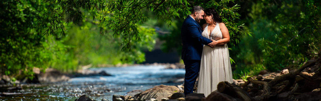 bride and groom private moment by river